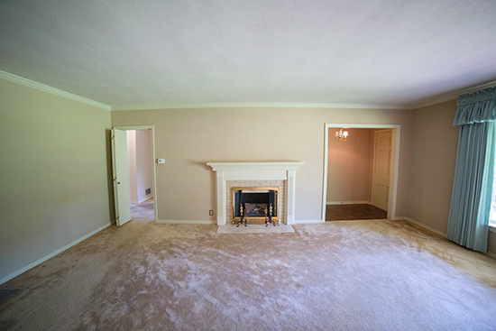 View of Living Room Front Door and Fireplace Wall