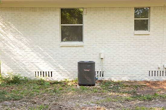 HVAC Condenser Unit Visible in Backyard