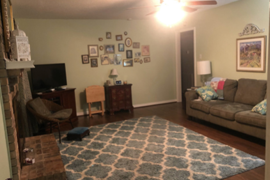 Lime Green Living Room Walls with Gallery Wall of Family Photos
