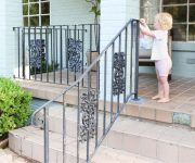 Baby Toddler Helping Paint Iron Handrails on 1950s Ranch Home