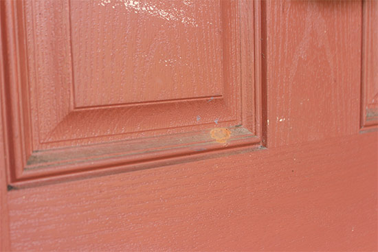 Dirty Red Front Door Before Cleaning