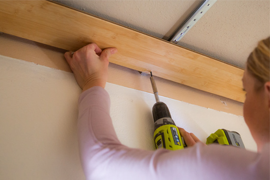 Installing First Plank of Floating Wood Ceiling